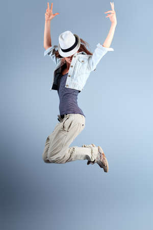 hip hop dance: A couple of young man and woman dancing hip-hop at studio. Stock Photo
