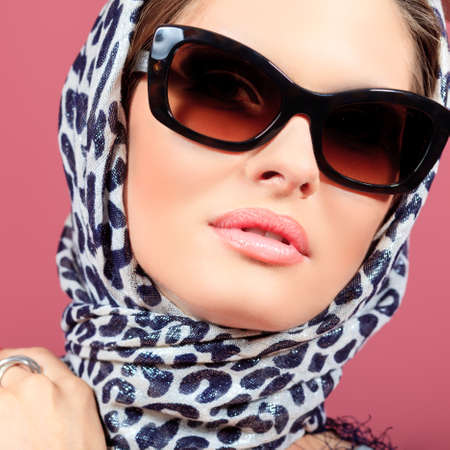 Portrait of an attractive young woman in sunglasses. Retro style. Stock Photo - 10489596