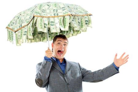 profiting: Concetto di business: uomo d'affari con un ombrello di denaro. Isolato su bianco.