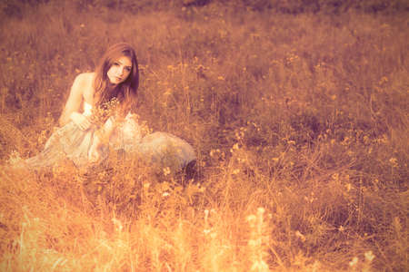 gypsy: Romantic young woman posing outdoor. Stock Photo