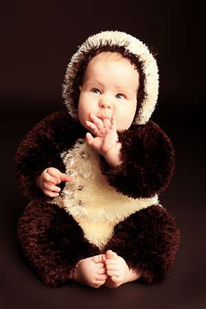 Beautiful baby in panda costume. Shot in a studio. photo