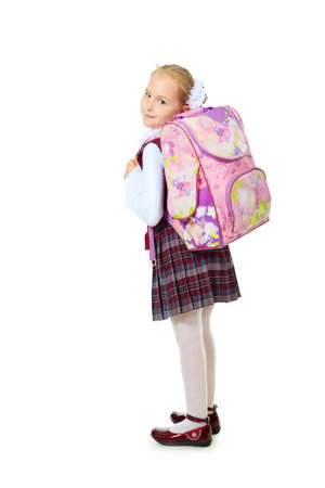 Portrait of a cute schoolgirl with a schoolbag. Isolated over white background. photo