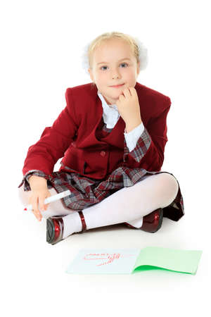 schoolgirls: Portrait of a cute schoolgirl with pen and workbook. Isolated over white background. Stock Photo