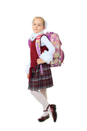 Portrait of a cute schoolgirl with a schoolbag. Isolated over white background. Stock Photo - 10545047