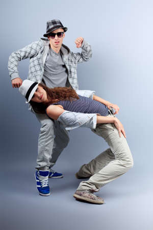 breakdance: A couple of young man and woman dancing hip-hop at studio. Stock Photo