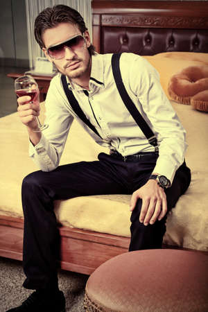 Portrait of a handsome fashionable man posing in the interior. Stock Photo - 11692237