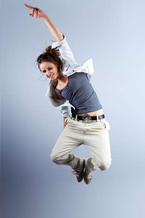 break dance: A couple of young man and woman dancing hip-hop at studio. Stock Photo