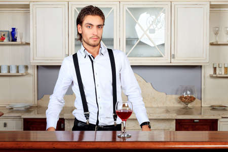 Portrait of a handsome fashionable man posing in the inter. Stock Photo - 11692236
