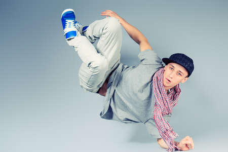 street dance: Young man dancing hip-hop at studio. Stock Photo