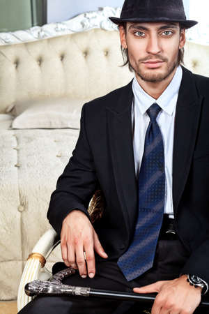 Portrait of a handsome fashionable man posing in the interior. Stock Photo - 11692240