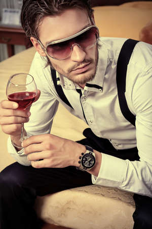 Portrait of a handsome fashionable man posing in the interior. Stock Photo - 10545173
