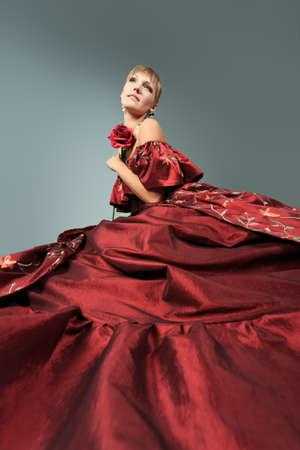 fancy dress costume: Portrait of a beautiful woman in medieval era dress. Shot in a studio. Stock Photo