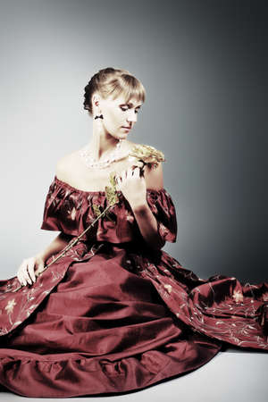 medieval woman: Portrait of a beautiful woman in medieval era dress. Shot in a studio. Stock Photo