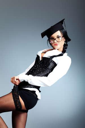 medias mujer: Sexy mujer joven con gafas posando sobre fondo gris. Foto de archivo