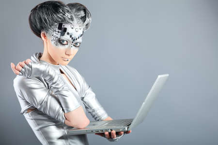 robot girl: Shot of a futuristic young woman with a laptop.  Stock Photo