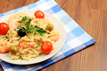 close up food: Food theme: pasta dish with shrimps and vegetables.