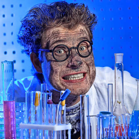 Medical theme: funny crazy scientist is working in a laboratory. 版權商用圖片