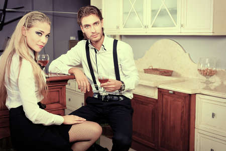 Portrait of a handsome fashionable man with  charming woman posing in the interior. Stock Photo - 10598019