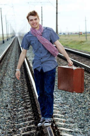 Portrait of a handsome young man posing at a railroad. Stock Photo - 10629327