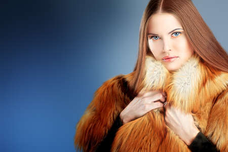 Portrait of a beautiful young woman in a fur. Stock Photo - 10629377