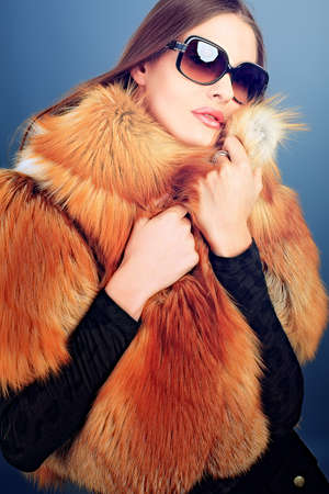 Portrait of a beautiful young woman in a fur. Stock Photo - 10629412