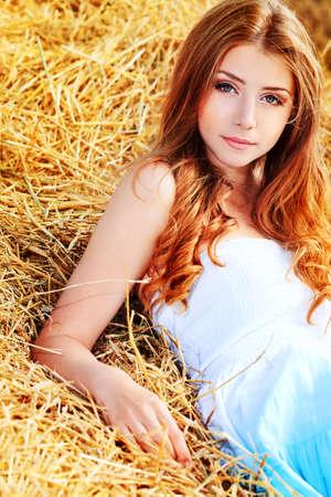 Romantic young woman posing outdoor. photo