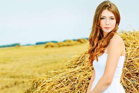 Romantic young woman posing outdoor. Stock Photo