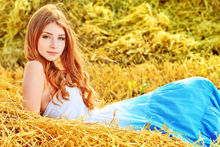 country life: Romantic young woman posing outdoor. Stock Photo