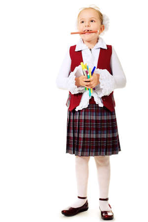 Portrait of a cute schoolgirl with pencils and crayons. Isolated over white background.