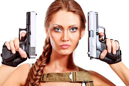 women with guns: Shot of a sexy military woman posing with guns. Isolated over white.