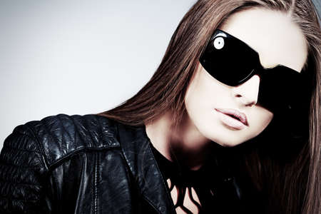 Portrait of an attractive young woman in sunglasses.  photo
