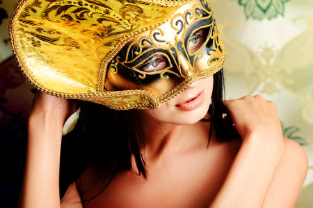 Shot of a sexy woman in a mask over vintage background. Stock Photo - 10703066