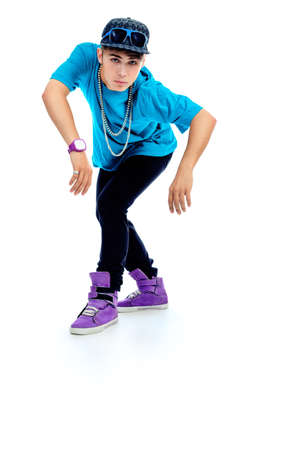 Stylish young man is dancing. Isolated over white background. photo