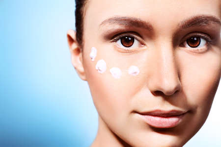 woman face cream: Portrait of beautiful spa girl with cream on her face. Stock Photo