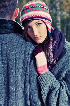 seasonal clothes: Portrait of a happy young couple in warm clothes outdoor.