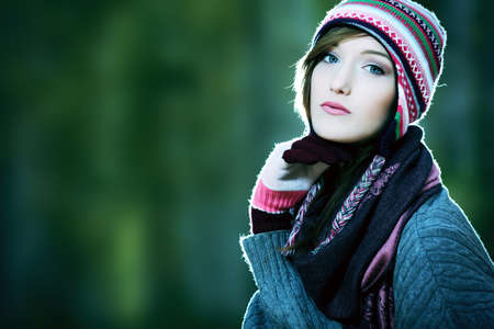 warm clothing: Beautiful young woman at the autumn park. Stock Photo