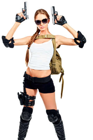 Shot of a sexy military woman posing with guns. Isolated over white. photo