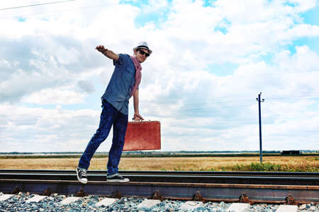 Portrait of a handsome young man posing at a railroad. Stock Photo - 10727523