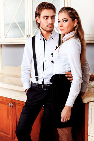 Portrait of a handsome fashionable man with  charming woman posing in the interior. Stock Photo - 10765166