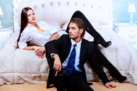 Portrait of a handsome fashionable man with  charming woman posing in the interior. Stock Photo - 10765207