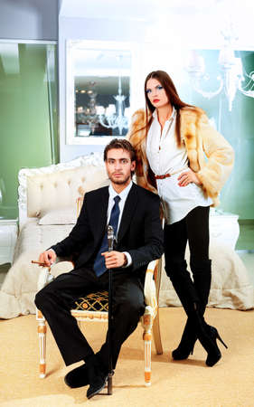 Portrait of a handsome fashionable man with  charming woman posing in the interior. Stock Photo - 10765199