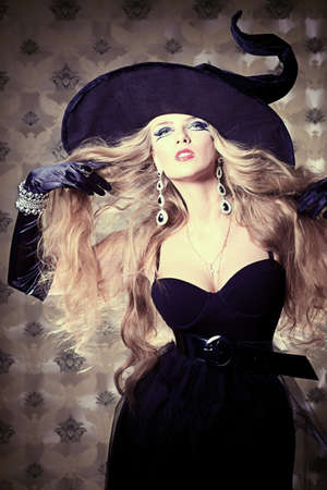 sexy halloween girl: Charming halloween witch over vintage background.