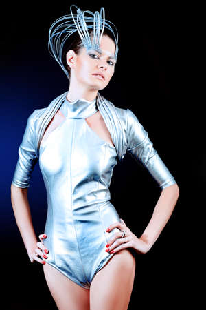 cyber woman: Fashion shot of a beautiful young woman over dark blue  background.