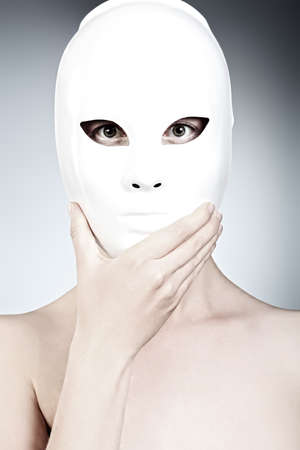 Shot of a woman in white mask over grey background. Stock Photo - 10793449