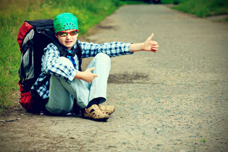 weekend activities: A boy teenager with knapsack posing outdoor. Tourism, active life.