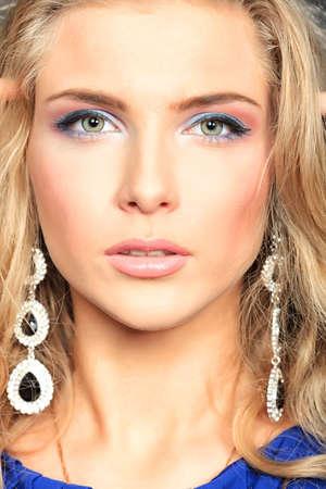 jewelry model: Portrait of a beautiful woman. Jewelry, make-up.