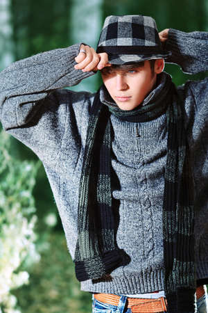 stylish boy: Handsome young man posing outdoor.