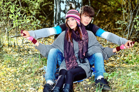 Portrait of a happy young couple in warm clothes outdoor. Stock Photo - 10834933