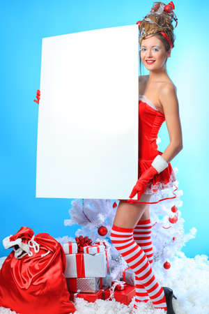 Beautiful young woman in Santa Claus clothes over Christmas background. Stock Photo - 10834964