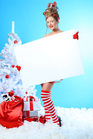 Beautiful young woman in Santa Claus clothes over Christmas background. Stock Photo - 10834965